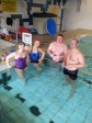 Gemma, Sophie, Chris and Neil (Dad) in the pool - about the 4 mile point!